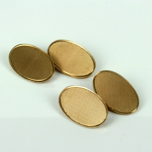 Antique cufflinks with a textured finish.
