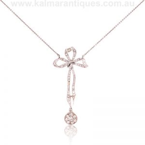 Art Deco diamond pendant set with a bow