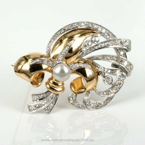 18ct rose gold diamond retro brooch.