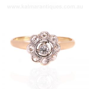 Charming Art Deco era diamond daisy ring from the 1920's
