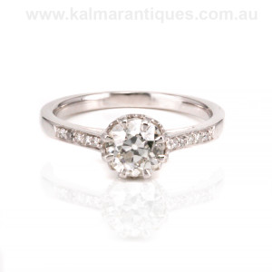 Diamond engagement ring set with an antique diamond