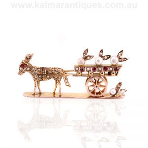 Antique brooch in the form of a donkey set with pearls, rubies and diamonds