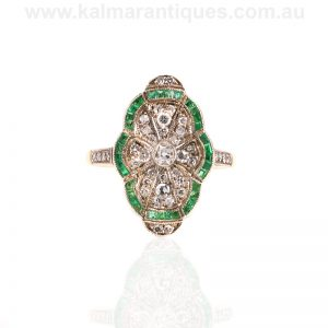 Scalloped shaped Art Deco style emerald and diamond ring