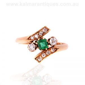 Antique emerald and diamond ring in a crossover design