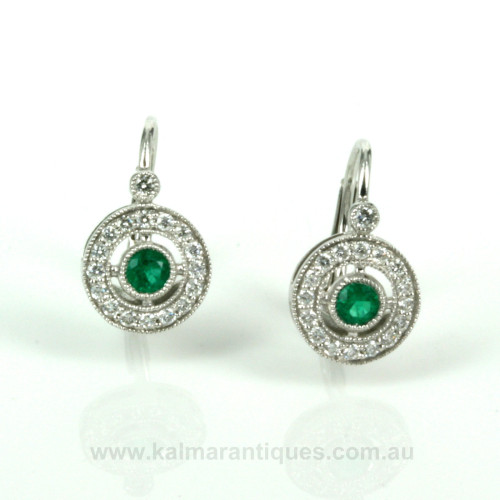 Emerald and diamond cluster earrings in 18ct gold