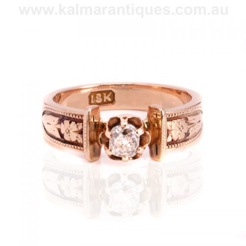 Antique rose gold mine cut diamond engagement ring