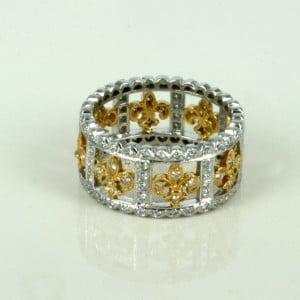 Fleur-de-lis diamond ring.