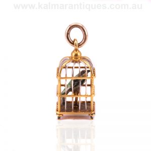 18ct gold and platinum charm pendant of a bird in a cage
