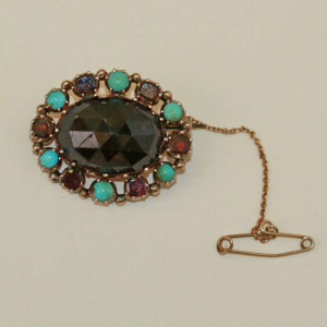 Victorian garnet and turquoise brooch.
