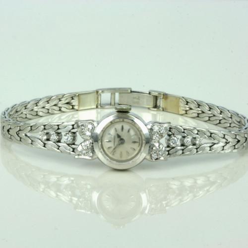 Diamond set Longines watch.