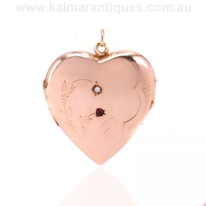 Antique 9 carat rose gold heart shaped garnet and pearl locket