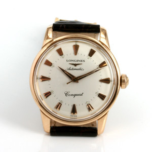 18ct gold vintage Longines Conquest watch.