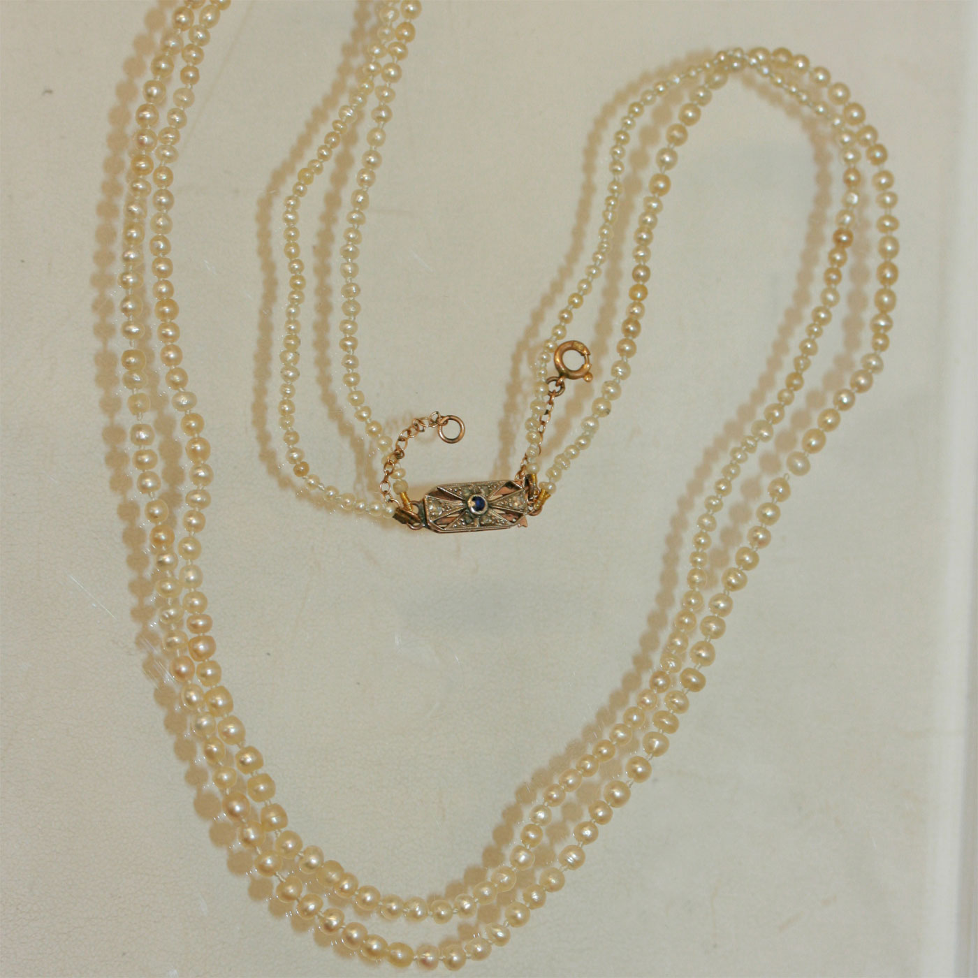 designed pearls as necklace and pin cultured a small diamond pearl one row natural of