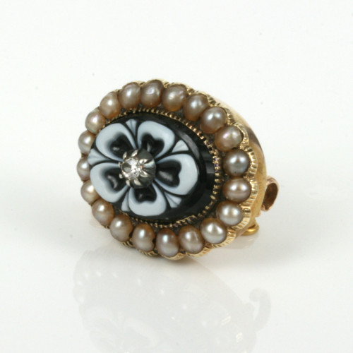Antique carved onyx and pearl brooch.