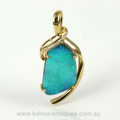 Stunning opal and diamond pendant
