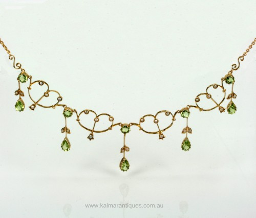 Antique Edwardian era peridot and pearl necklace .