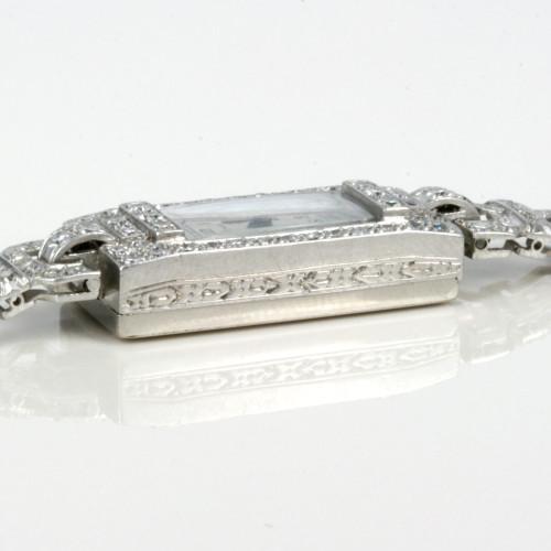 Platinum Cyma diamond watch.