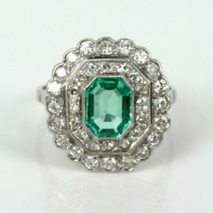 Platinum emerald and diamond double cluster ring