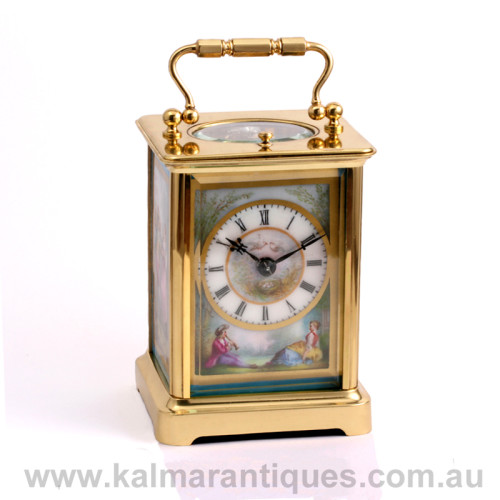 Antique repeater carriage clock with enamel panels