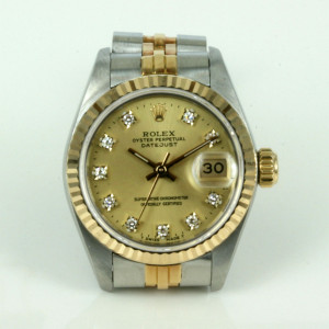 Ladies diamond dial Rolex watch in steel and gold.