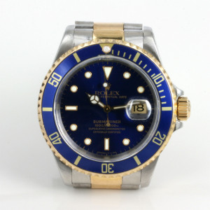 Blue dial Rolex Submariner in gold & steel
