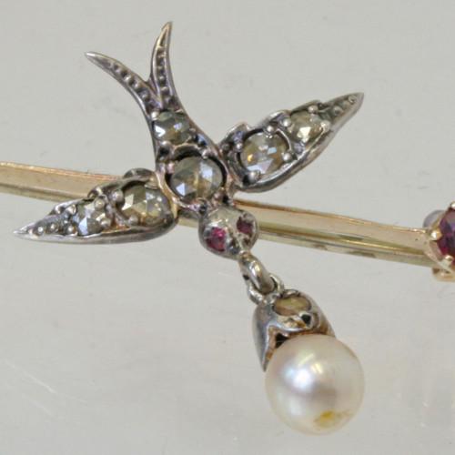 Rose cut diamond bird brooch.