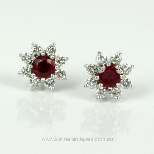 Burmese ruby earrings each surrounded by 8 diamonds