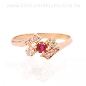 Antique ruby and diamond ring with a split designed band