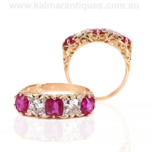 Antique ruby and diamond engagement ring with scroll work on the sides.