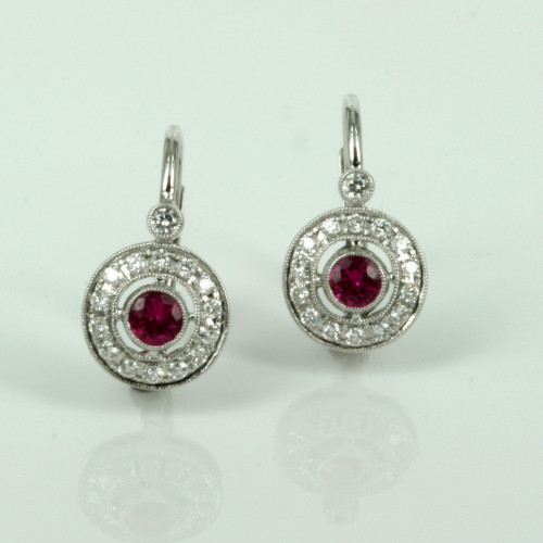 18ct white gold ruby earrings with 30 diamonds.