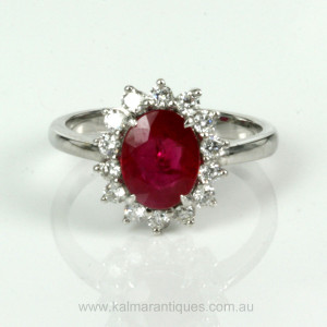 Burmese ruby ring surrounded by 14 diamonds