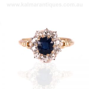 Antique sapphire and diamond cluster engagement ring