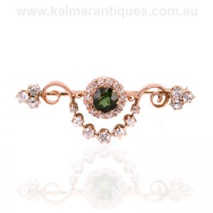 Antique green tourmaline and diamond brooch