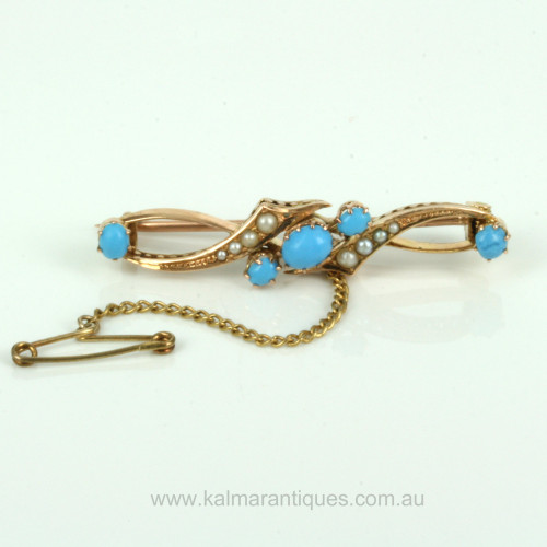 Antique turquoise and pearl brooch from the 1900's.